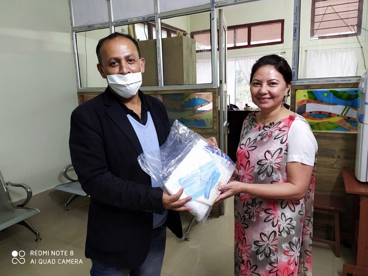 (From L-R) Member Secretary, MSLSA hand over the PPEs to Smt. R.M. Kurbah, IAS, Deputy Commssioner, Ri-Bhoi District on the 25th April 2020